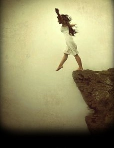 girl-stepping-off-cliff