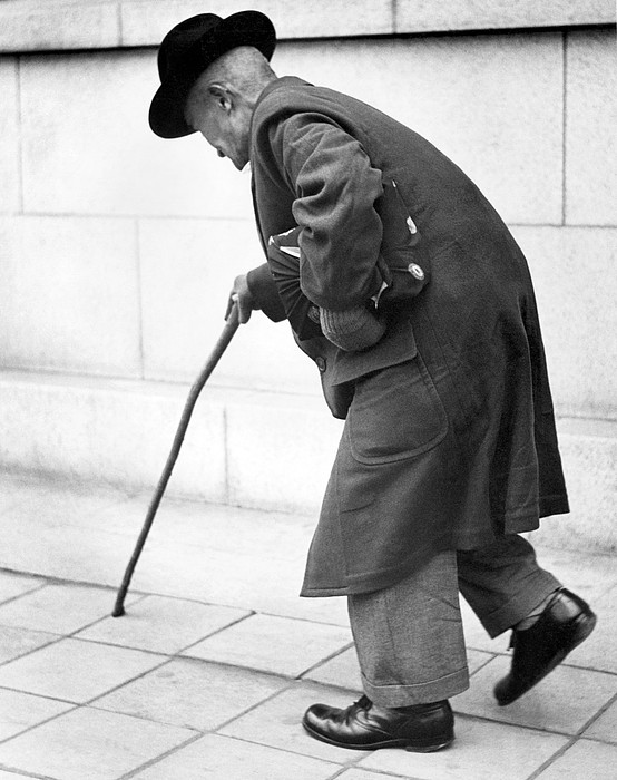 old-man-walking-with-a-cane-underwood-archives